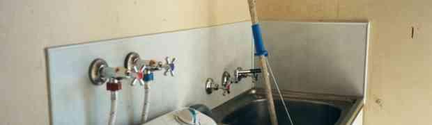 Como desentupir o tanque de lavar roupas